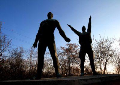 Giant Statues Reaching towards the heavens