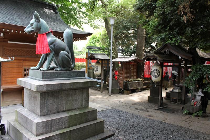 Giant fox statue with a bib
